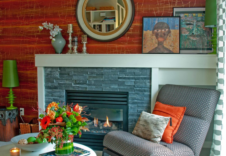 Red orange wallpaper, gray rock fireplace.