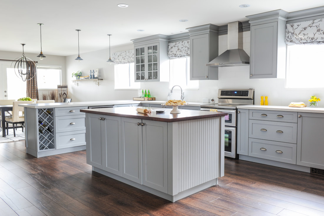 Gray kitchen cabinets, butcher block counter