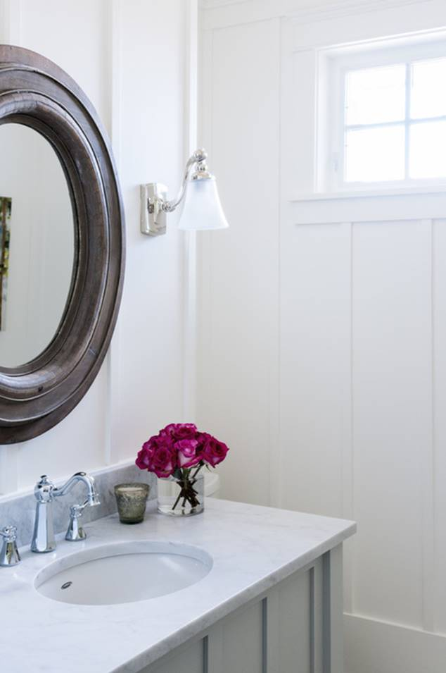 Powder room marble counter simply white walls.