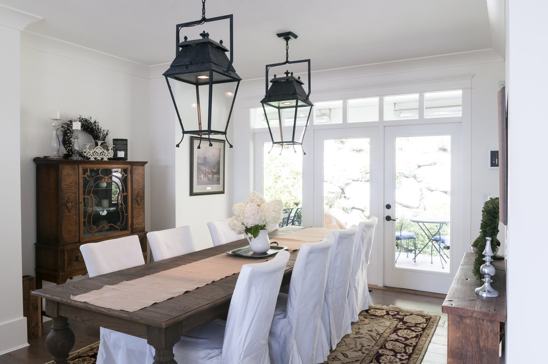 White dining room, black pendant lights